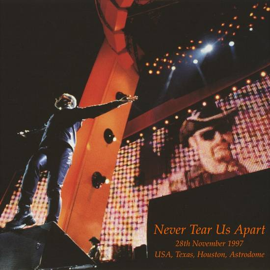1997-11-28-Houston-NeverTearUsApart-Front.jpg